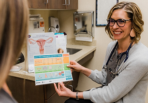 Tracy Hansen holding a women's health pamphlet