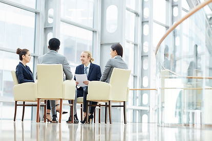 business-experts-discussing-sales-data-M