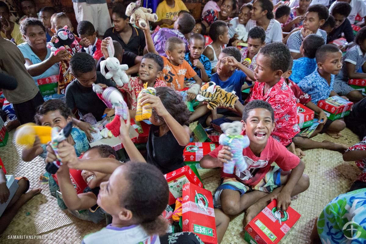 OCC- Lots of kids opening boxes