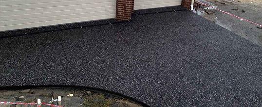 Exposed-coloured-concrete-calgary-black-