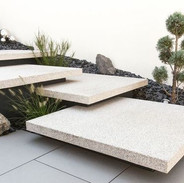 white concrete floating stairs