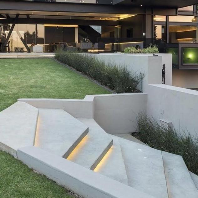 unique concrete lights uner steps