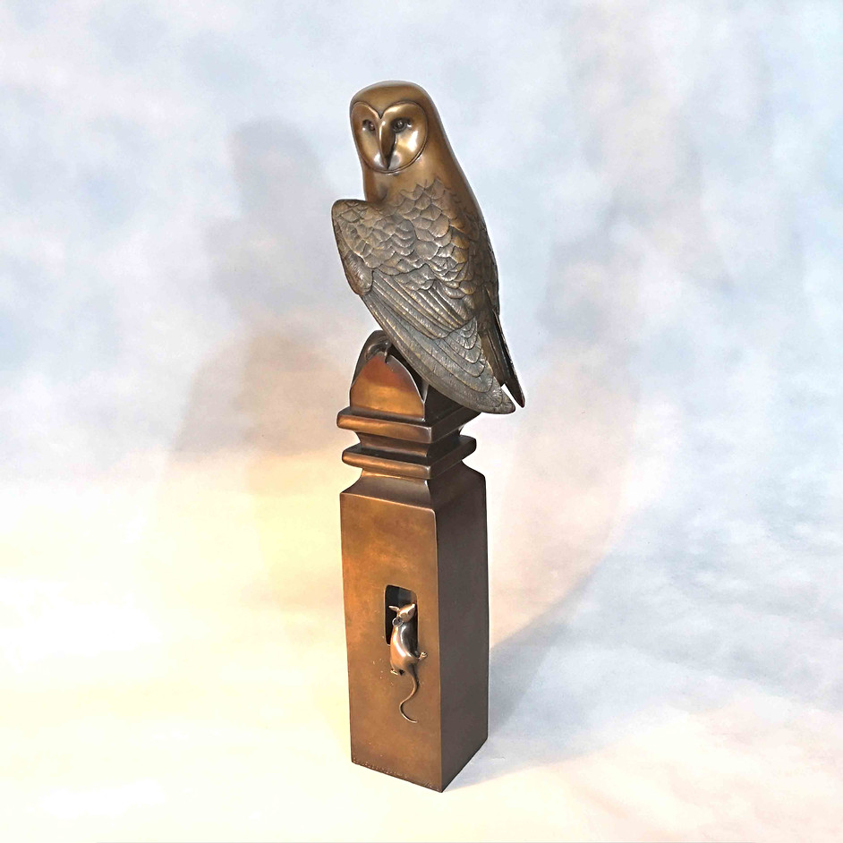 Barn Owl on a Post with Mouse