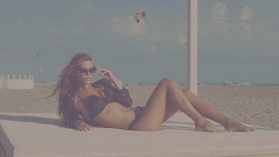 girl-tanning-on-beach.jpg