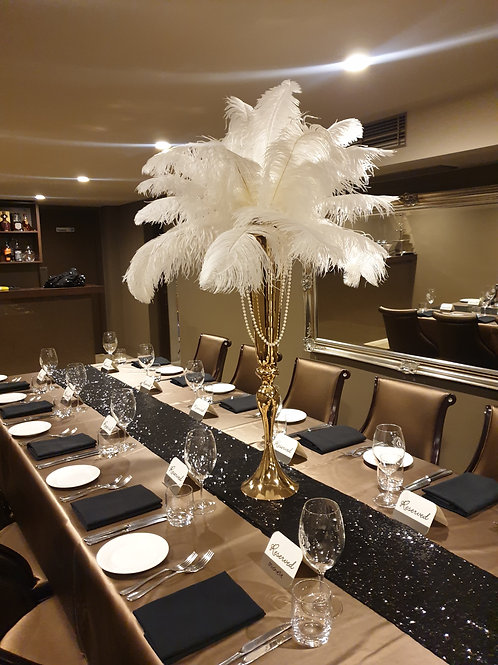 Feather Arrangement in Tall Vases
