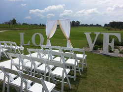 LOVE sign at wedding ceremony