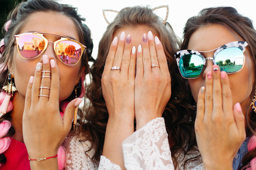 Close up of three young girls wearing in