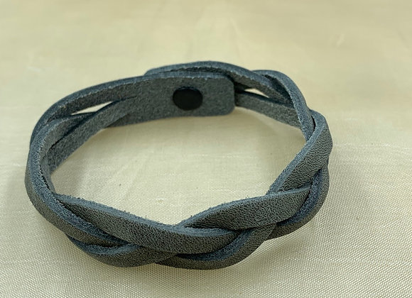 Braided leather cuff with snap clasp