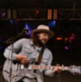 Tyson playing e guitar.jpg