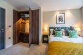 Bedroom with wardrobe open.jpg