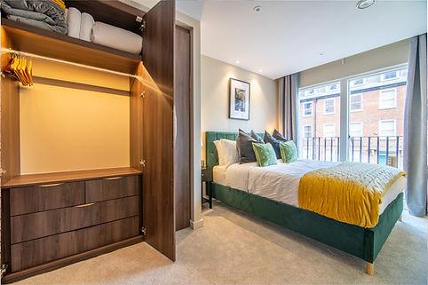 Wardrobe in bedroom open.jpg