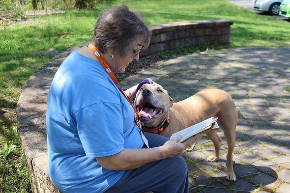 Flo reading to long-time resident Korbin