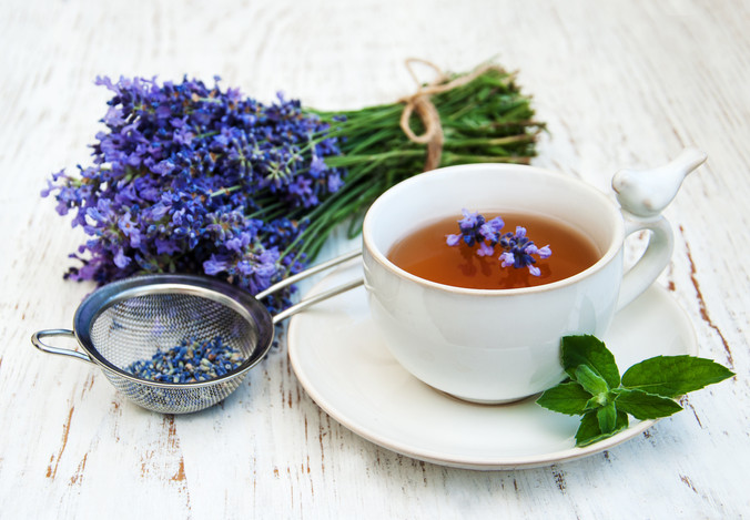 Cup of tea and lavender flowers on a old
