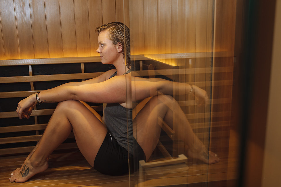 Blond fit woman in The Breathing Rooms Infrared Sauna Jacuzzi Clearlight