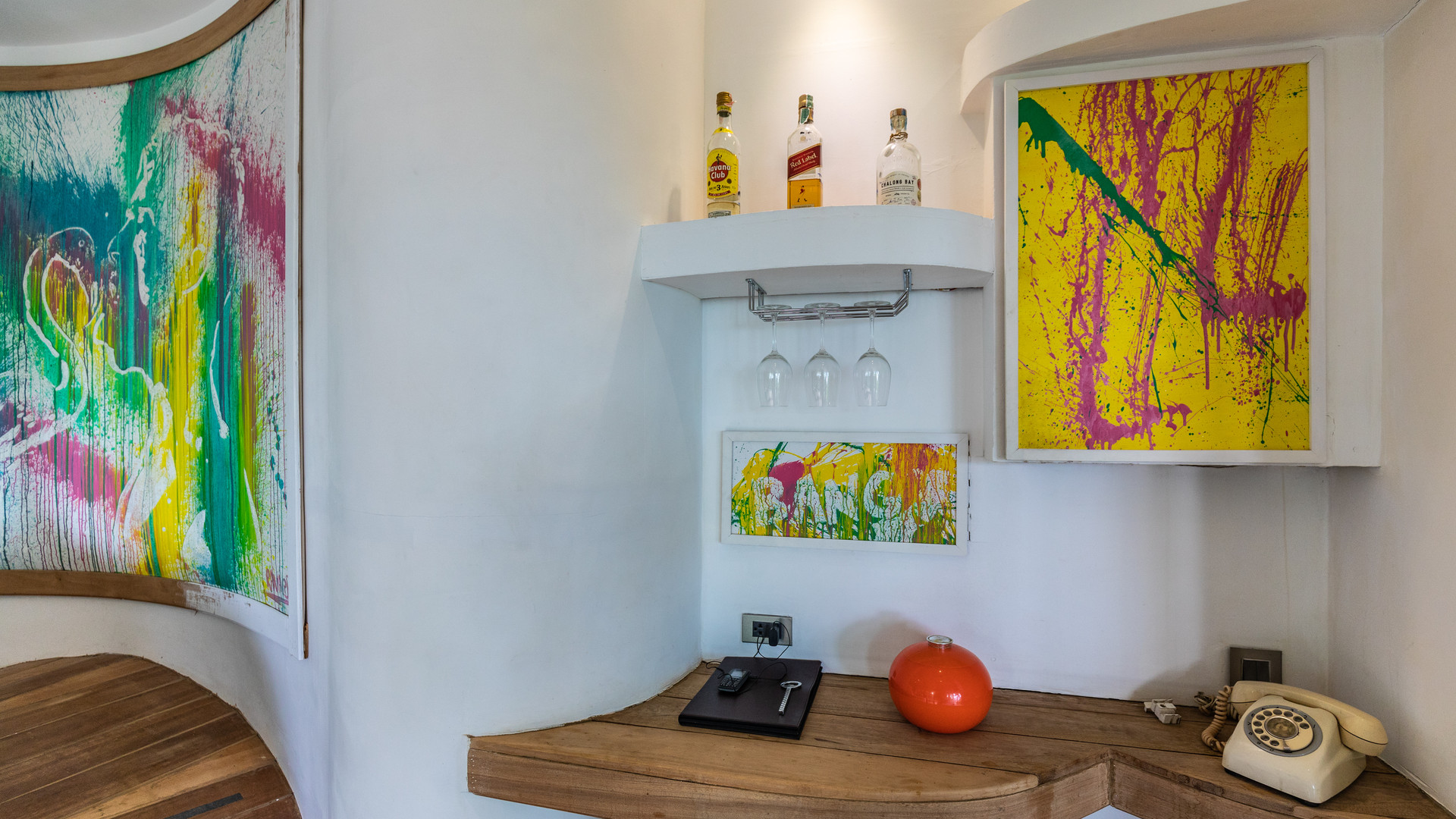 Paintings hidding the safe and minibar at Hedonist Villa