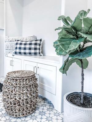 rye modern tudor mudroom, fiddle leaf fig, bench, tile flooring, family friendly design