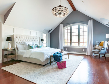 Wide shot of beautifully designed bedroom with lots of natural light and a family friendly king sized bed