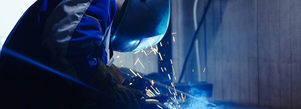 industrial-worker-at-the-factory-welding