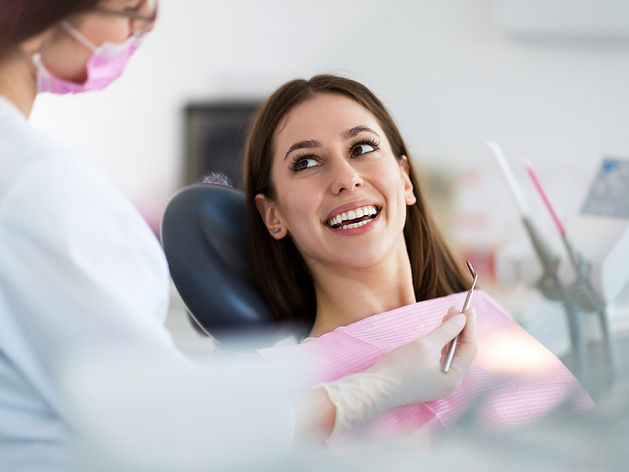 Dentist-and-patient-in-dentist-232666948