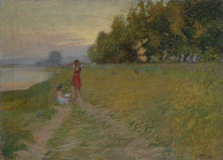 Ragazze lungo l'argine del fiume