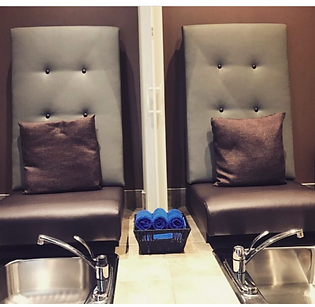 Pedicure Chairs with stainless steel sinks.