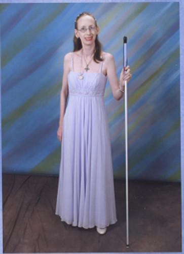 This is one of the few pictures of me with a white cane taken in July 2010.  I'm only a size 2 in this picture following three years at the time of taking a very strong prescription migraine medicine that nearly killed me (I weighed just 83 lbs at the time).