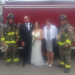 Shari and Alistair and firefighters.jpg