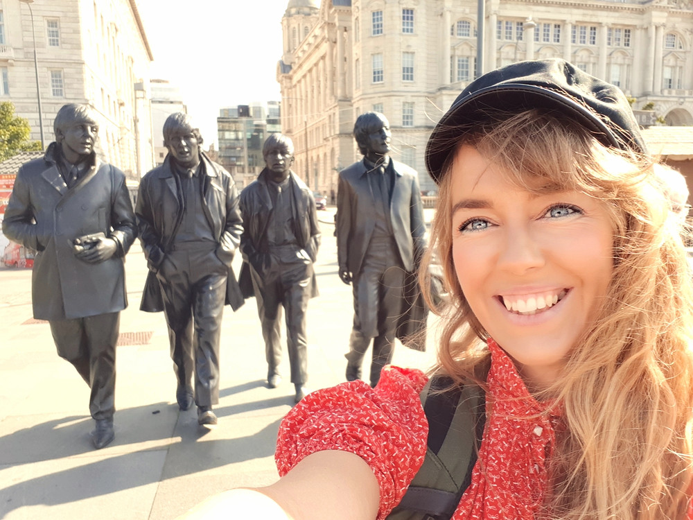 Pernille Eriksen and The Beatles statue at Pier Head in Liverpool.
