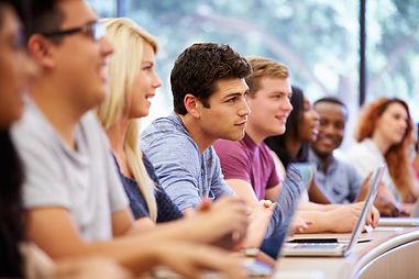teens-group-college-classroom-smiling-la