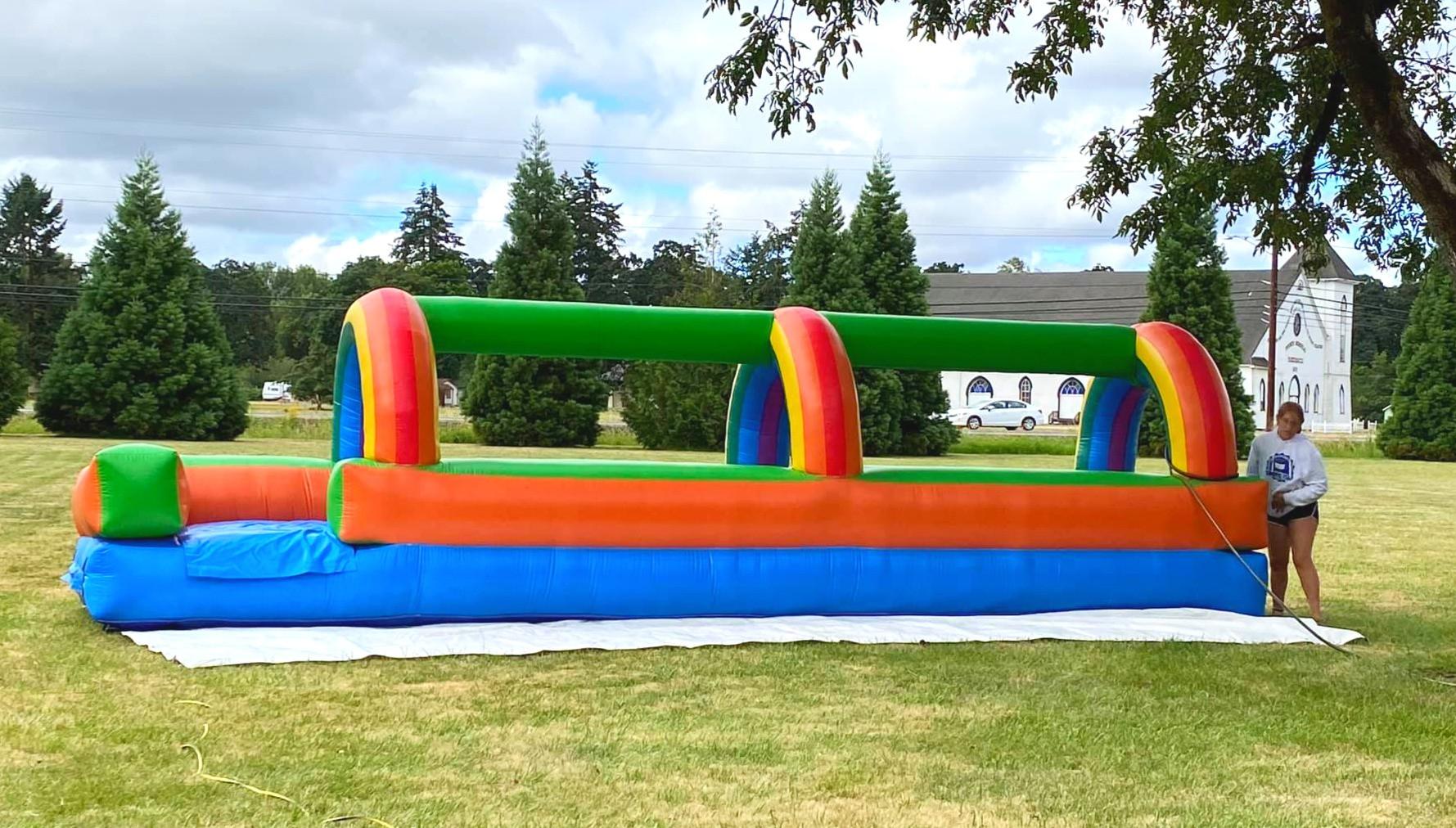 Inflatable Slip in Slide by Salem Jumper Rentals LLC