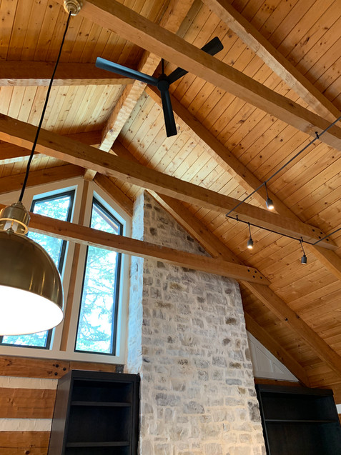 Residenial lighting design: custom architectural rail lighting + fixture layout compatible with hand hewn beams.