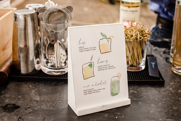 Illustrated drink menu for event cocktails.