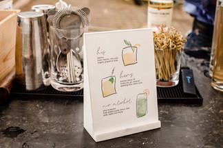 Illustrated drink menu for event cocktails.