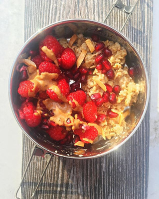 Creamy Oatmeal with Pomegranate and Raspberry Topping