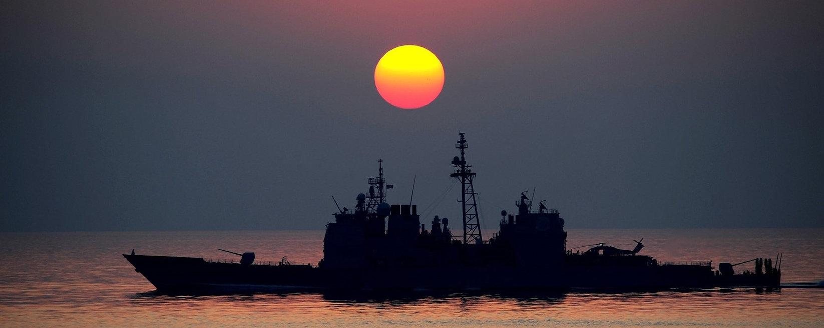 US Navy Ship at Sunset.jpg