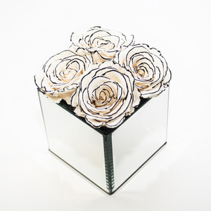 Zebra roses that last a year in a stylish mirrored cube. Similar to a chanel style and perfect for salon decor, interior decor and gift ideas.