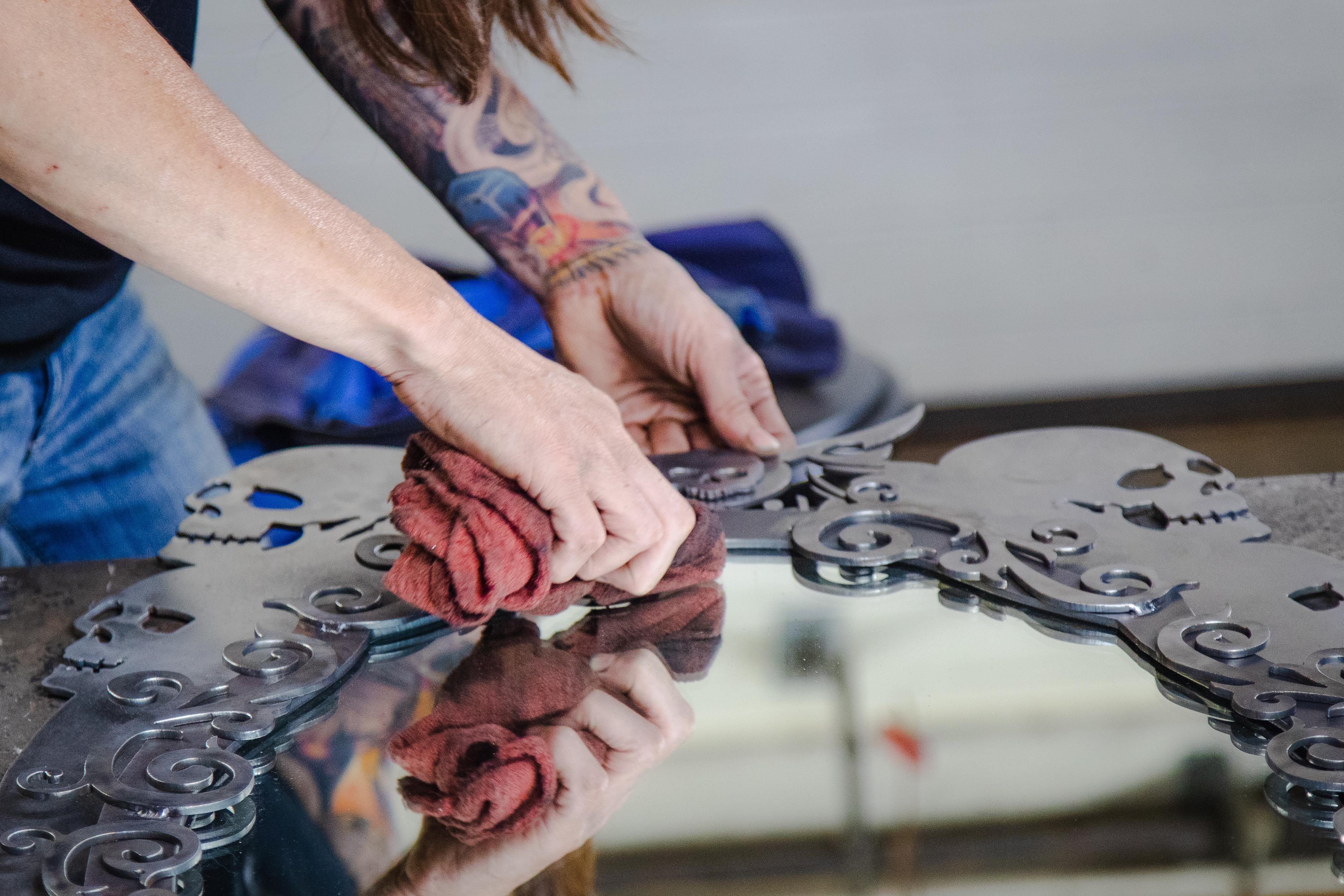 Barbie The Welder cleaning the Memento Mori skull mirror