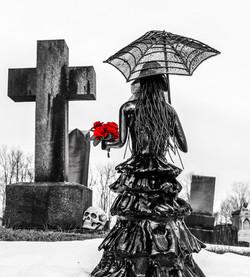 Death's Widow woman in a graveyard