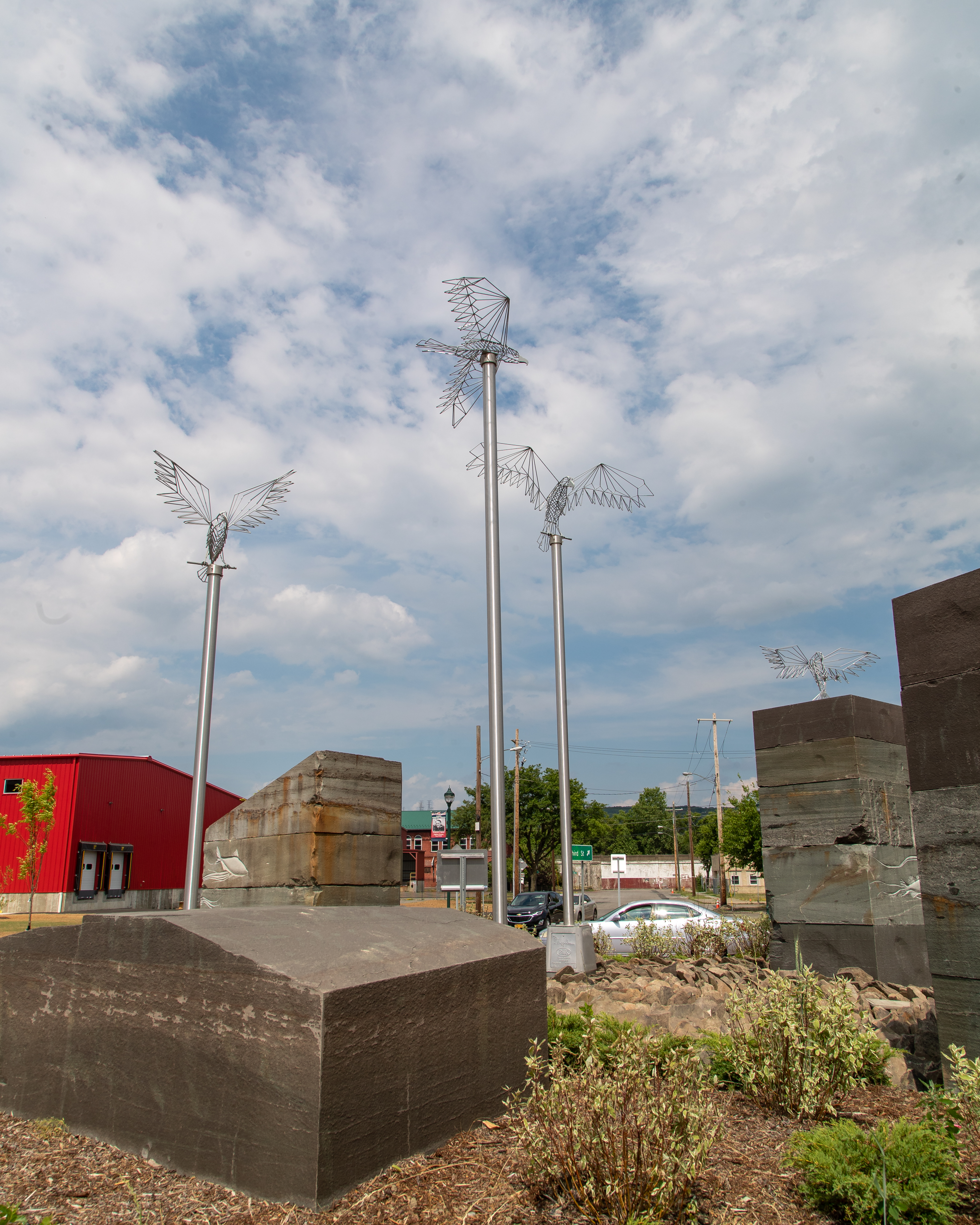 Barbie The Welder eagles and osprey sculptures installed in Elmira, NY