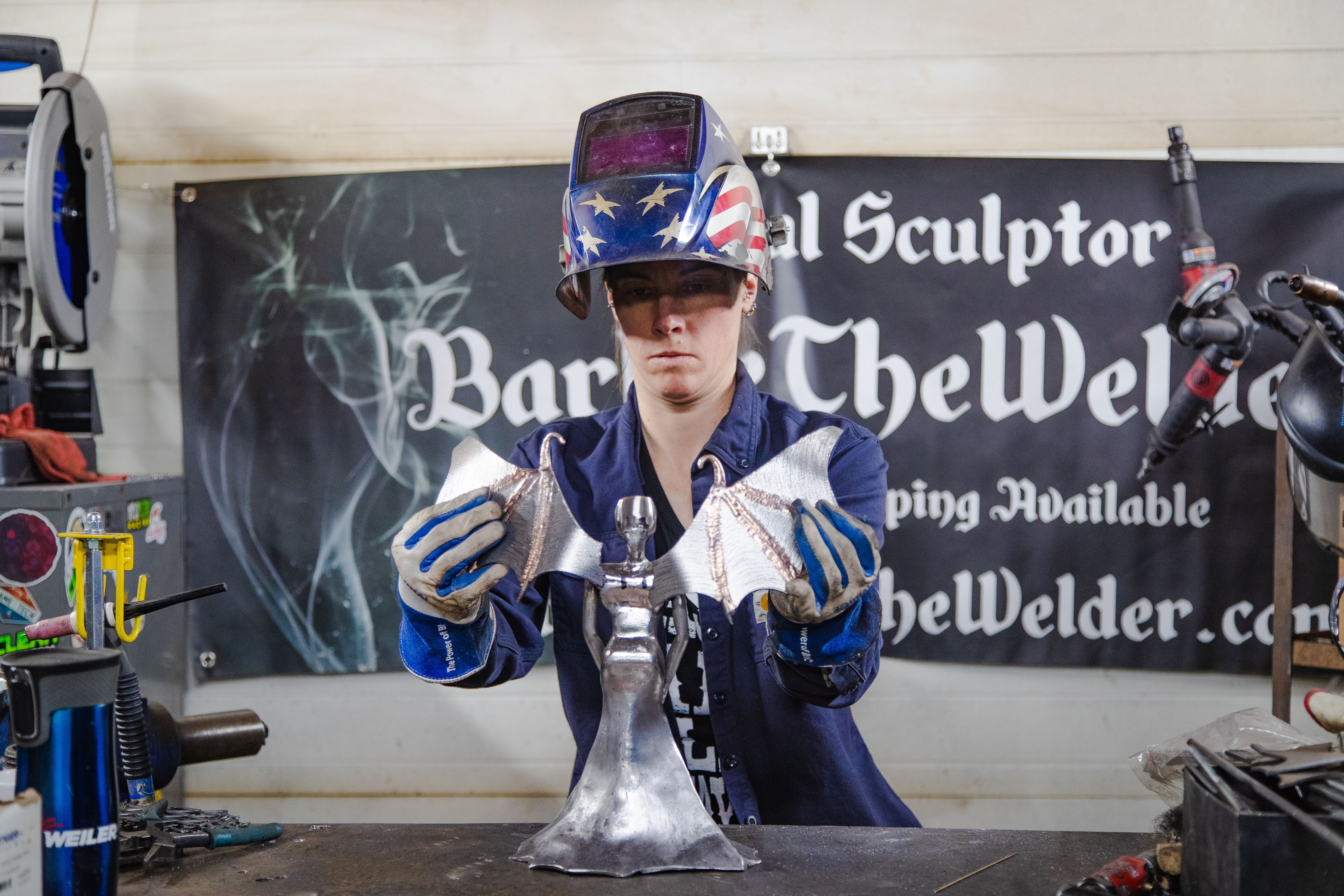 Barbie The Welder fitting the wings for Matilda Bat woman
