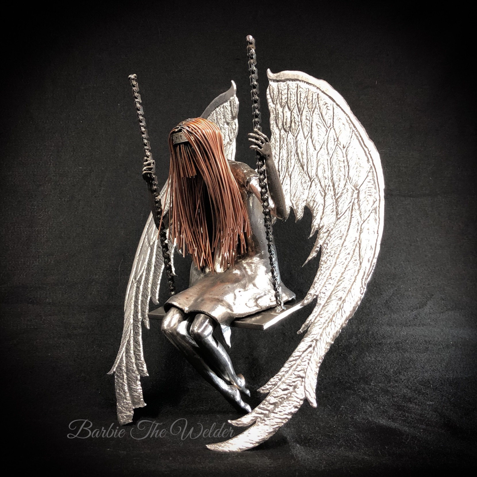 broken angel metal sculpture