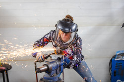 Barbie The Welder cutting steel with Chicago Pneumatic extended cutter