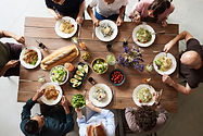 Canva - Group of People Eating Together.