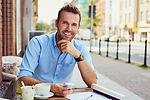Happy man having coffee break at outdoor