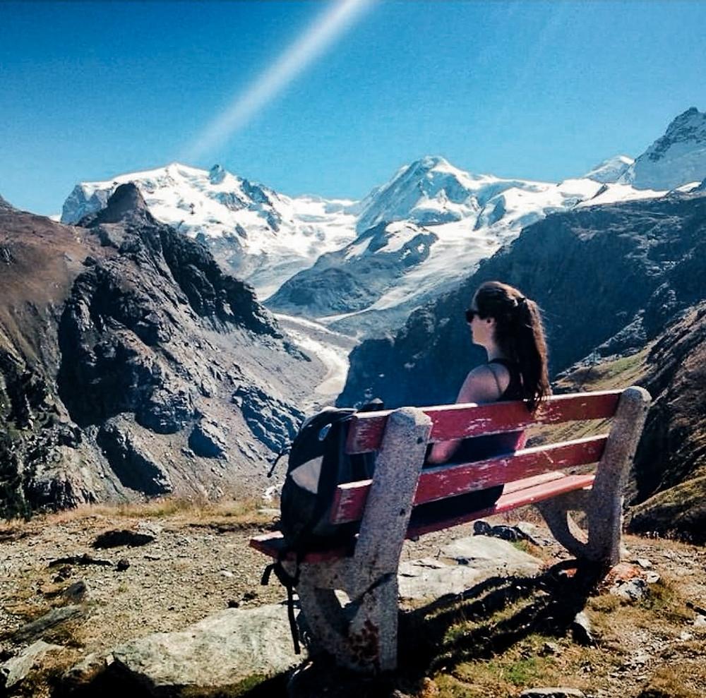 Mountains in Zermatt Switzerland with Girl Sitting on Bench