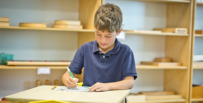 Child in classroom at Montessori Learning Center
