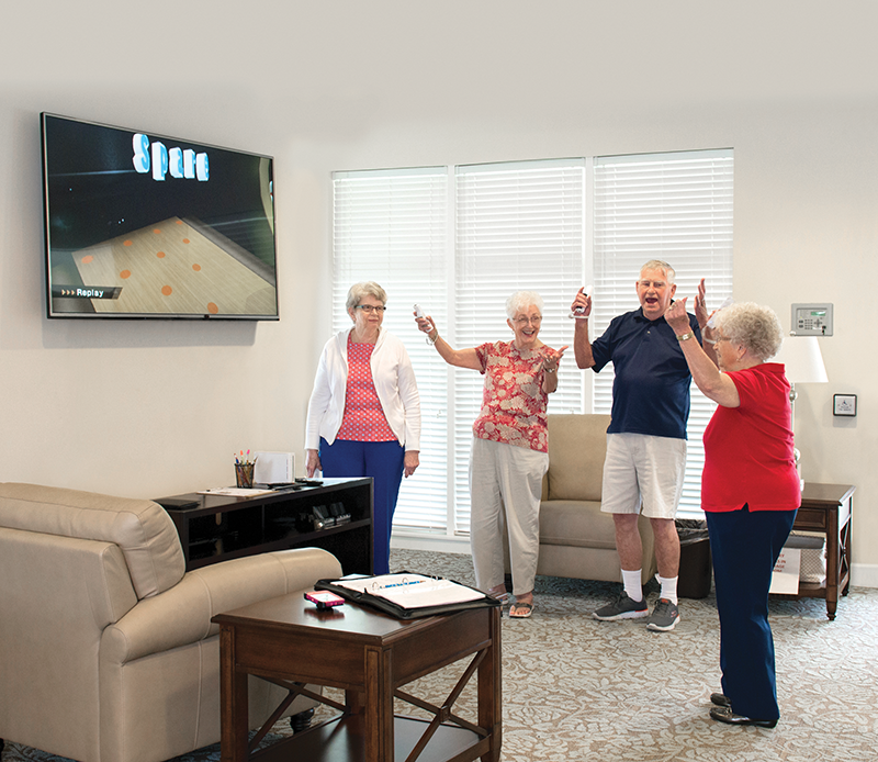 Residents playing Wii bowling
