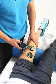 Physiotherapy, doctor examining adult patient knee injury
