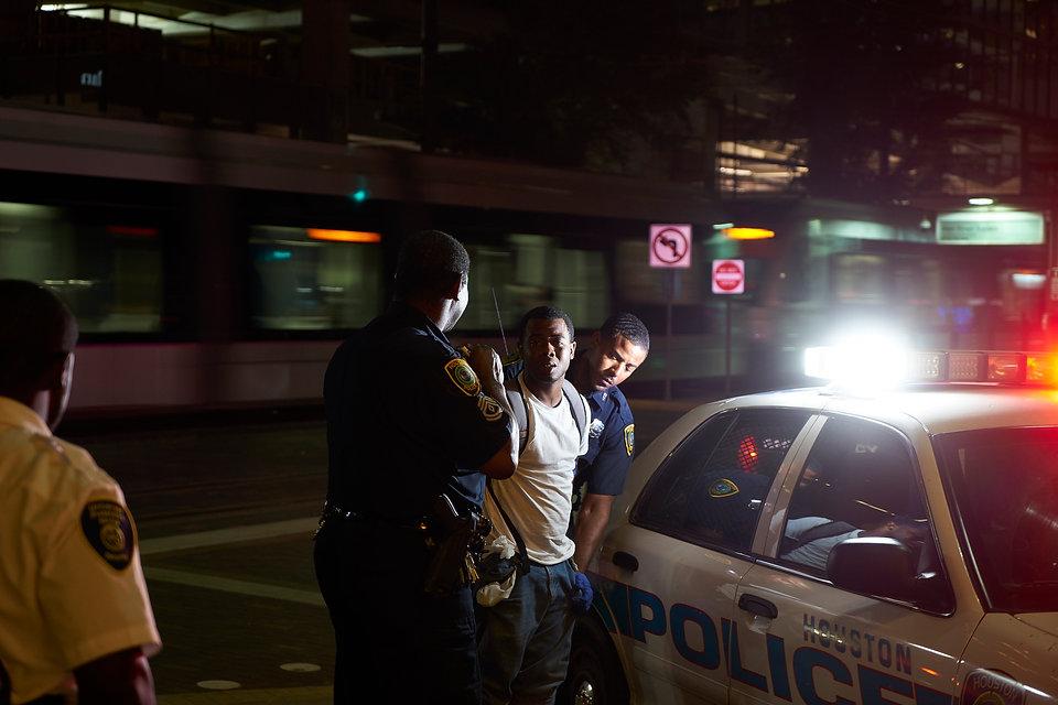 Houston_Police_arresting_young_man.jpg
