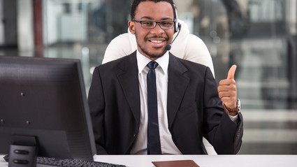 smiling-assistant-is-using-headset-call-